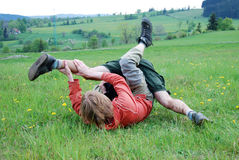 Man fight. Two young man fight in nature stock photo