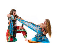 Man fight with young woman for dress Royalty Free Stock Images