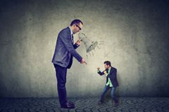 Man fighting against his big angry boss Stock Photos