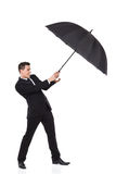 Man fighting with an umbrella Royalty Free Stock Photos