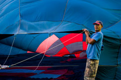 Man fill hot air in balloon Royalty Free Stock Images