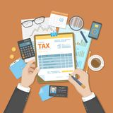 Man fill the tax form. State Government taxation. Human hands, tax form, money, calculator, wallet, calendar, credit card. Pay the bills, invoices, payrolls Stock Photos