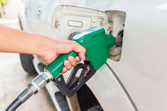 Man fill up fuel at a gas station. Royalty Free Stock Photo