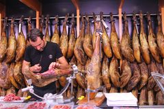 Butcher filets Spanish ham Iberico, Valencia, Spain Royalty Free Stock Image