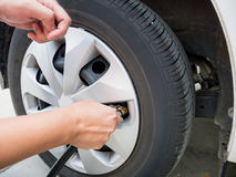Man filling air pressure in the car tyre Royalty Free Stock Photography