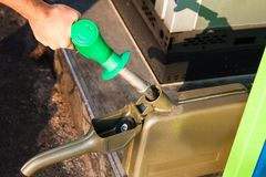 Man filling canister with petrol Royalty Free Stock Images