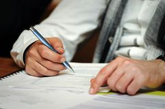 Man Filling Forms Royalty Free Stock Image