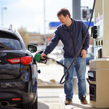 Man filling gasoline fuel in car Royalty Free Stock Photography