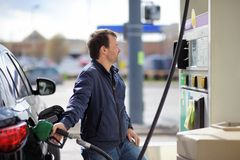 Man filling gasoline fuel in car Royalty Free Stock Images
