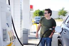 Man filling gasoline fuel in car Stock Photos