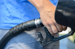 Man filling his car with gasoline Stock Photography