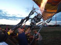 Man filling hot air into balloon Stock Photo