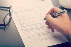 Man filling a job application form Royalty Free Stock Photo