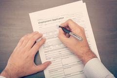 Man filling a job application form Royalty Free Stock Image