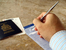 Man filling out form Stock Images