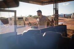 Man filling petrol in car at petrol pump Stock Images