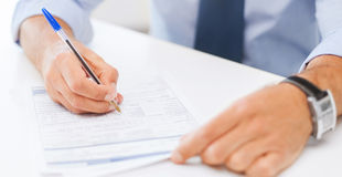 Man filling tax form Royalty Free Stock Photo