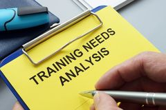 Man filling in training needs analysis. Documents royalty free stock photo