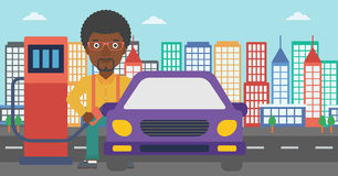 Man filling up fuel into car. An african-american man filling up fuel into the car on a city background vector flat design illustration. Horizontal layout Royalty Free Stock Photo