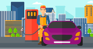 Man filling up fuel into car. Stock Photography