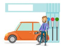 Man filling up fuel into the car at a gas station. Young caucasian white businessman in suit filling up fuel into the car at the gas station. Hipster man with Royalty Free Stock Images