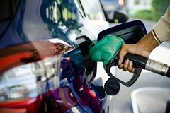 Man filling up gas in his car stock images