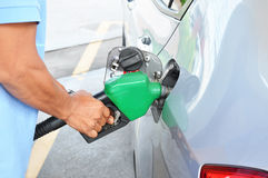 A man filling up the gas tank of a car. Car gas (petrol) filling up royalty free stock photos