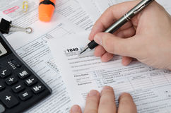 Man filling US tax form stock photography