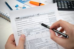 Man filling US tax form. royalty free stock photography