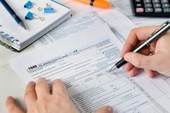 Man filling US tax form. stock photos