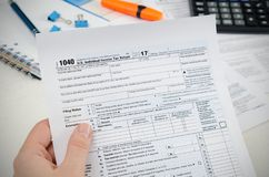 Man filling US tax form. royalty free stock images