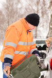 Man filling woman car gas winter assistance Royalty Free Stock Photos