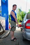 Man fills car with gasoline royalty free stock photo