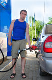 Man fills car with gasoline Royalty Free Stock Images