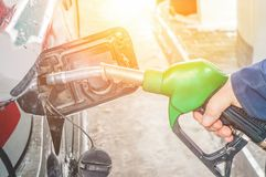 Man fills the gas tank of the car. The concept of price changes for petroleum products and petrol.  royalty free stock photography