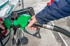 Man fills the gas tank of the car. The concept of price changes for petroleum products and petrol.  stock photography