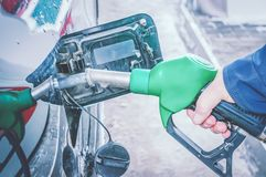 Man fills the gas tank of the car. The concept of price changes for petroleum products and petrol.  royalty free stock image