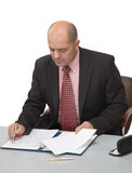 Man fills the papers, sitting at the table Royalty Free Stock Photography