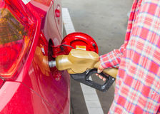 Man fills up car with a gasoline Royalty Free Stock Photos