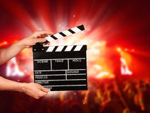 Man with film clapper on concert Stock Image