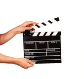Man with film clapper on white background Royalty Free Stock Images