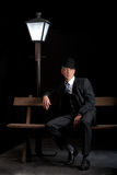 Man Film noir man lamppost bench Royalty Free Stock Photos