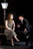 Man Film noir couple street lantern bench Royalty Free Stock Images