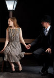Man Film noir couple street lantern bench Stock Photography