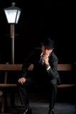 Man Film noir man lamppost bench Royalty Free Stock Photos