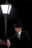Man Film noir man lamppost bench Royalty Free Stock Image