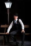 Man Film noir man lamppost bench Royalty Free Stock Images