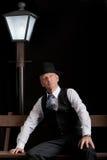 Man Film noir man lantern bench Stock Photography