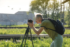 A man is filming outdoor. Royalty Free Stock Image