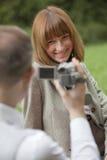 Man filming woman Royalty Free Stock Photo